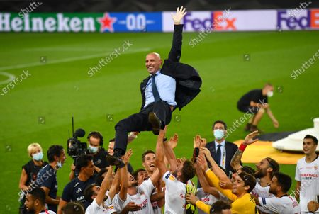 Stock Picture of Ramon Rodriguez Verdejo, Director of Football of Seville celebrates with players following the UEFA Europa League Final between Seville and FC Internazionale at RheinEnergieStadion on August 21, 2020 in Cologne, Germany.