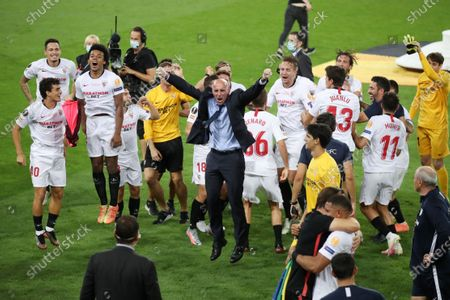 Ramon Rodriguez Verdejo, Director of Football of Seville celebrates with players following the UEFA Europa League Final between Seville and FC Internazionale at RheinEnergieStadion on August 21, 2020 in Cologne, Germany.