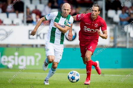Dutch Arjen Robben of FC Groningen (L) duels with Frederik Helpstrup of Almere City during the Eredivisie match between Almere City FC and FC Groningen at the Yanmar stadium in Almere, The Netherlands, 22 August 2020. The 36-year-old routine makes his return to the Dutch fields.