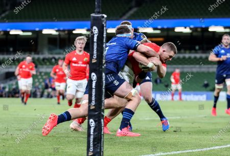 Leinster vs Munster. Munster's Andrew Conway scores a try despite Caelan Doris and Sean Cronin of Leinster