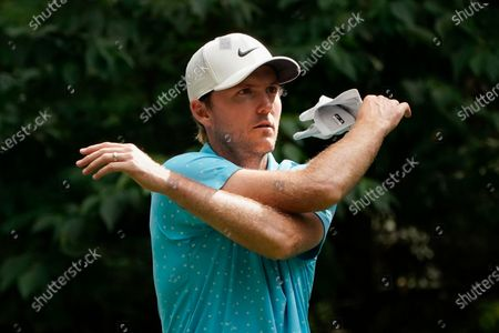 Russell Henley loosens up before his tee shot on the ninth hole during the third round of the Northern Trust golf tournament at TPC Boston, in Norton, Mass