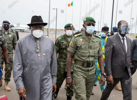 Former Nigerian President Goodluck Jonathan (L) walks with Colonel Malick Diaw (C) vice-president of the CNSP (National Committee for the Salvation of the People) on his arrival at the International Airport in Bamako, Mali, 22 August 2020. A delegation of West African leaders led by former Nigerian president Goodluck Jonathan arrived in Bamako to help negotiations in the wake of the coup. Mali President Ibrahim Boubakar Keita resigned 19 August 2020 after a coup by the military on 18 August 2020 with the National Committee for the Salvation of the People (CNSP) now in control.