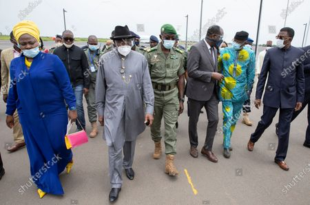 Former Nigerian President Goodluck Jonathan (C-L) walks with Colonel Malick Diaw (C) vice-president of the CNSP (National Committee for the Salvation of the People) on his arrival at the International Airport in Bamako, Mali, 22 August 2020. A delegation of West African leaders led by former Nigerian president Goodluck Jonathan arrived in Bamako to help negotiations in the wake of the coup. Mali President Ibrahim Boubakar Keita resigned 19 August 2020 after a coup by the military on 18 August 2020 with the National Committee for the Salvation of the People (CNSP) now in control.