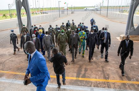 A delegation of West African leaders led by former Nigerian president Goodluck Jonathan (C-L) walk with Colonel Malick Diaw (C) vice-president of the CNSP (National Committee for the Salvation of the People) on their arrival at the International Airport in Bamako, Mali, 22 August 2020. A delegation of West African leaders led by former Nigerian president Goodluck Jonathan arrived in Bamako to help negotiations in the wake of the coup. Mali President Ibrahim Boubakar Keita resigned 19 August 2020 after a coup by the military on 18 August 2020 with the National Committee for the Salvation of the People (CNSP) now in control.