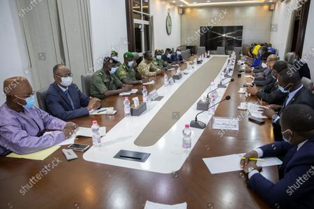 Mali military leaders from the National Committee for the Salvation of the People (CNSP) meet with a delegation from the Economic Community of West African States (ECOWAS)  in Bamako, Mali, 22 August 2020. A delegation of West African leaders led by former Nigerian president Goodluck Jonathan arrived in Bamako to help negotiations in the wake of the coup. Mali President Ibrahim Boubakar Keita resigned 19 August 2020 after a coup by the military on 18 August 2020 with the National Committee for the Salvation of the People (CNSP) now in control.