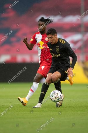 Red Bull Salzburg's Majeed Ashimeru (L) in action against Ajax Amsterdam's Edson Alvarez (R) during a pre-season friendly soccer match between FC Red Bull Salzburg and Ajax Amsterdam in Salzburg, Austria, 22 August 2020.
