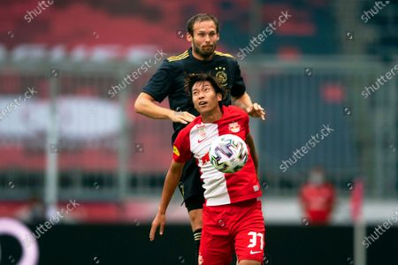 Ajax Amsterdam's Daley Blind (up) in action against Red Bull Salzburg's Masaya Okugawa (front) during a pre-season friendly soccer match between FC Red Bull Salzburg and Ajax Amsterdam in Salzburg, Austria, 22 August 2020.