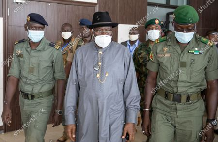 Former Nigerian President Goodluck Jonathan (C) walks with Colonel Malick Diaw (R) vice-president of the CNSP (National Committee for the Salvation of the People) on his arrival at the International Airport in Bamako, Mali, 22 August 2020. A delegation of West African leaders led by Goodluck Jonathan arrived in Bamako to help negotiations in the wake of the coup. Mali President Ibrahim Boubakar Keita resigned 19 August 2020 after a coup by the military on 18 August 2020 with the National Committee for the Salvation of the People (CNSP) now in control.