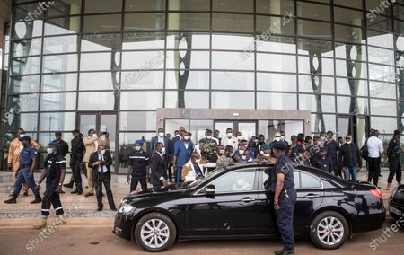 Media and security look on as the vehicle for former Nigerian president Goodluck Jonathan prepares to depart after his arrival at the airport in Bamako, Mali, . Top West African officials are arriving in Mali's capital following a coup in the nation this week to meet with the junta leaders and the deposed president in efforts to negotiate a return to civilian rule