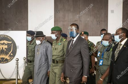 Stock Picture of Former Nigerian president Goodluck Jonathan, 2nd left, is welcomed by spokesman for the National Committee for the Salvation of the People (CNSP) Ismael Wague, left, and CNSP official Malick Diaw, 3rd left, followed by other officals, upon his arrival at the airport in Bamako, Mali . Top West African officials are arriving in Mali's capital following a coup in the nation this week to meet with the junta leaders and the deposed president in efforts to negotiate a return to civilian rule