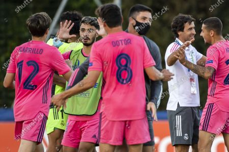 Real Madrid's head coach Raul Gonzalez Blanco (2-R) celebrates with his players after winning the UEFA Youth League semi final soccer match between FC Salzburg and Real Madrid at the Colovray Sports Centre stadium in Nyon, Switzerland, 22 August 2020.