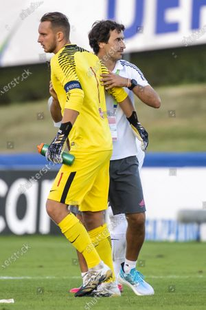 Real Madrid's head coach Raul Gonzalez Blanco (R) and Salzburg's goalkeeper Daniel Antosch (L) react during the UEFA Youth League semi final soccer match between FC Salzburg and Real Madrid at the Colovray Sports Centre stadium in Nyon, Switzerland, 22 August 2020.