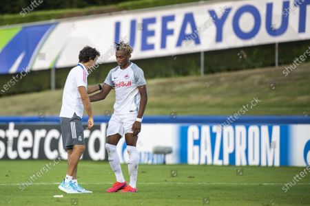 Real Madrid's head coach Raul Gonzalez Blanco (L) talks with Salzburg's forward Chikwubuike Adamu (R) during the UEFA Youth League semi final soccer match between FC Salzburg and Real Madrid at the Colovray Sports Centre stadium in Nyon, Switzerland, 22 August 2020.