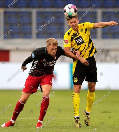 Dortmund's Lukasz Piszczek (R) in action against Feyenoord's Nicolai Jorgensen (L) during the pre-season friendly soccer match between Borussia Dortmund and Feyenoord Rotterdam in Duisburg, Germany, 22 August 2020.