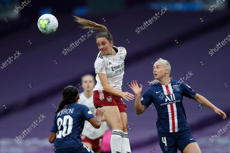 Arsenal's Lisa Evans jumps to head the ball during the Women's Champions League quarterfinal soccer match between Arsenal and Paris Saint-Germain at the Anoeta stadium in San Sebastian, Spain