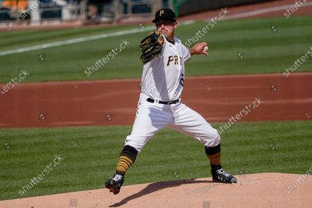 Pittsburgh Pirates starter Derek Holland pitches against the Milwaukee Brewers in the first inning of a baseball game, in Pittsburgh