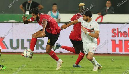 Al Ahly's Marwan Mohsen (L) in action against Zamalek's  goal keeper Mahmoud Alaa (R) during the Egyptian Premier League soccer match between Zamalek SC and Al Ahly SC in Cairo, Egypt, 22 August 2020.