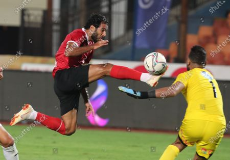 Al Ahly's Marwan Mohsen (L) in action against Zamalek's  goal keeper Mohamed abou Gabel (R) during the Egyptian Premier League soccer match between Zamalek SC and Al Ahly SC in Cairo, Egypt, 22 August 2020.