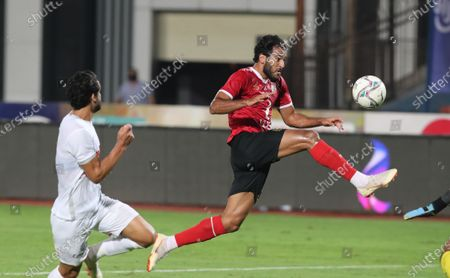 Al Ahly's Marwan Mohsen (R) in action against Zamalek's  goal keeper Mahmoud Alaa (L) during the Egyptian Premier League soccer match between Zamalek SC and Al Ahly SC in Cairo, Egypt, 22 August 2020.