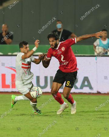Al Ahly's Marwan Mohsen (R) in action against Zamalek's  Tarek Hamed  (L) during the Egyptian Premier League soccer match between Zamalek SC and Al Ahly SC in Cairo, Egypt, 22 August 2020.