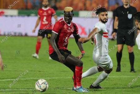 Stock Image of Al-Ahly player Aliou Deing (L) in action against Al-Zamalek player Ferjani Sassi (R) during the Egyptian Premier League soccer match between Al-Zamalek and Al-Ahly at Cairo stadium, in Cairo, Egypt, 22 August 2020