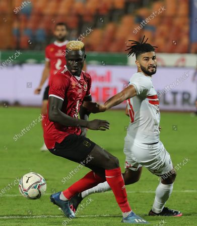 Stock Photo of Al-Ahly player Aliou Deing (L) in action against Al-Zamalek player Ferjani Sassi (R) during the Egyptian Premier League soccer match between Al-Zamalek and Al-Ahly at Cairo stadium, in Cairo, Egypt, 22 August 2020