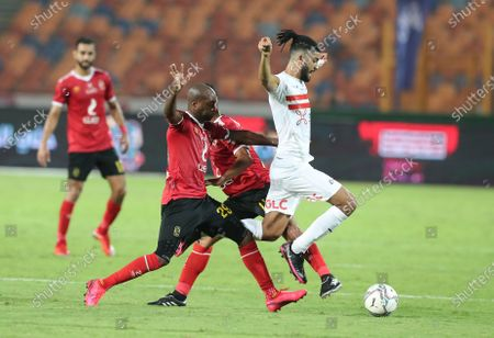Al-Ahly player Geraledo (L) in action against Al-Zamalek  player  Ferjani Sassi (R) during the Egyptian Premier League soccer match between Al-Zamalek and Al-Ahly at Cairo stadium  in Cairo Egypt, 22 August 2020.