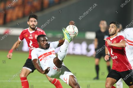 Stock Photo of Al-Ahly player Ayman Ashraf (R) in action against Al-Zamalek  player  Kabongo Kasongo (L) during the Egyptian Premier League soccer match between Al-Zamalek and Al-Ahly at Cairo stadium  in Cairo Egypt, 22 August  2020