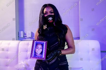 Actress Porsha Williams poses for a photo with a photo of Breonna Taylor at the Taylor-Made Women's Empowerment Event at Vibes presented by Until Freedom on day one of BreonnaCon, in Louisville, KY
