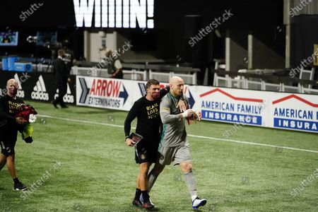 Stock Picture of Atlanta United interim manager Stephen Glass, left, and goalkeeper Brad Guzan walk off the field after an MLS soccer match against Nashville SC, in Atlanta