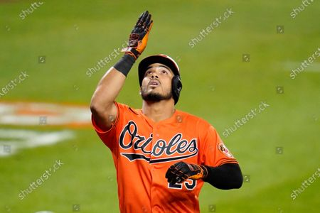 Baltimore Orioles' Anthony Santander gestures after hitting a two-run home run off Boston Red Sox relief pitcher Josh Taylor during the eighth inning of a baseball game, in Baltimore. The Orioles won 5-4 in ten innings