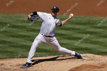 New York Yankees pitcher James Paxton (65) delivers a pitch against the Tampa Bay Rays during the first inning of a baseball game, in New York
