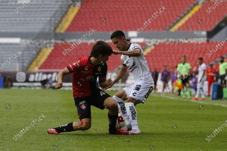 Jose Abella (L) of Atlas in action against Julio Cesar Nava (R) of Queretaro during the Liga MX 2020 Apertura Tournament soccer match between Atlas and Queretaro at Jalisco Stadium in Guadalajara, Mexico, 22 August 2020.