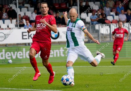 Arjen Robben of FC Groningen in action vs Frederik Helstrup of Almere City during the friendly soccer match between Almere City FC and FC Groningen at the Yanmar stadium. The 36-year-old player makes his return to the Dutch fields.