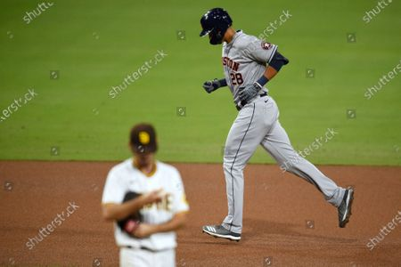 Houston Astros designated hitter Taylor Jones, right, rounds the bases after a solo home run off San Diego Padres starting pitcher Zach Davies during the fifth inning of a baseball game in San Diego