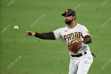 San Diego Padres second baseman Greg Garcia throws to first base during the ninth inning of a baseball game against the Houston Astros in San Diego, . The Padres won 13-2