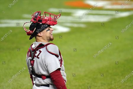 Stock Photo of Boston Red Sox catcher Christian Vazquez reacts while talking with home plate umpire Andy Fletcher during the first inning of a baseball game against the Baltimore Orioles, in Baltimore