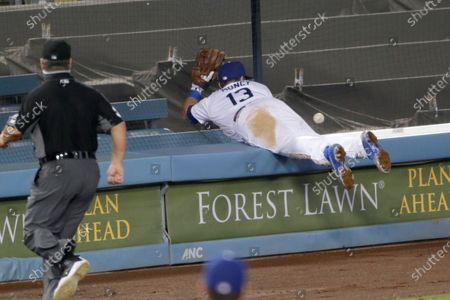 Los Angeles Dodgers third baseman Max Muncy (13) cannot catch a foul-fly ball hit by Colorado Rockies' Daniel Murphy, during the eighth inning of a baseball game in Los Angeles