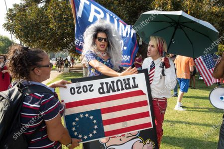 Stock Image of An anti Trump protester and Trump supporter Ricky Rebel