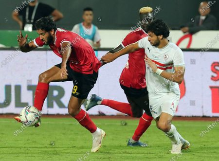 Marwan Mohsen (L) of Al-Ahly competes during an Egyptian Premier League football match between Zamalek and Al-Ahly in Cairo, Egypt, Aug. 22, 2020.