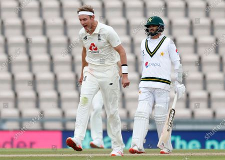 England's Stuart Broad, left, celebrates the dismissal of Pakistan's Yasir Shah during the third day of the third cricket Test match between England and Pakistan, at the Ageas Bowl in Southampton, England