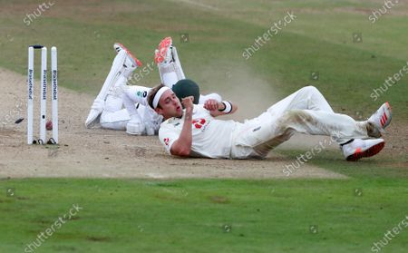 England's Stuart Broad, right, collides with Pakistan's captain Azhar Ali in an unsuccessful run-out attempt during the third day of the third cricket Test match between England and Pakistan, at the Ageas Bowl in Southampton, England