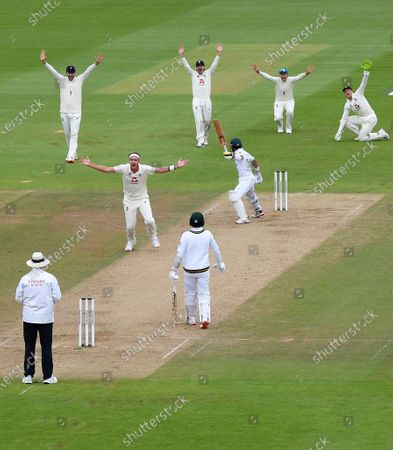 England's Stuart Broad, center left, appeals unsuccessfully for the wicket of Pakistan's Mohammad Rizwan, center right, during the third day of the third cricket Test match between England and Pakistan, at the Ageas Bowl in Southampton, England