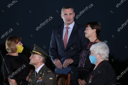 Kyiv city head Vitali Klitschko (C) and chief of Ivan Bohun Kyiv Military Lyceum, Hero of Ukraine Ihor Hordiichuk (2nd L) attend the ceremony of hoisting the largest Ukrainian flag (16 by 24 metres) on the 90m(295ft) tall flagpole at the National Museum of the History of Ukraine in WWII Memorial Complex, Kyiv, capital of Ukraine.