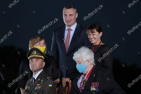 Kyiv city head Vitali Klitschko (C) and chief of Ivan Bohun Kyiv Military Lyceum, Hero of Ukraine Ihor Hordiichuk (L) attend the ceremony of hoisting the largest Ukrainian flag (16 by 24 metres) on the 90m(295ft) tall flagpole at the National Museum of the History of Ukraine in WWII Memorial Complex, Kyiv, capital of Ukraine. Ukrinform. /KDR/