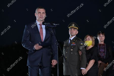 Kyiv city head Vitali Klitschko delivers a speech during the ceremony of hoisting the largest Ukrainian flag (16 by 24 metres) on the 90m(295ft) tall flagpole at the National Museum of the History of Ukraine in WWII Memorial Complex, Kyiv, capital of Ukraine.