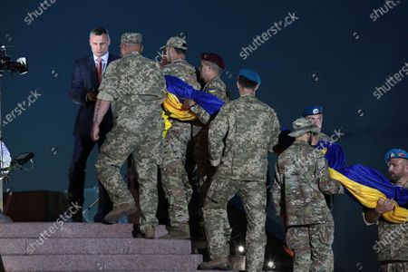 Kyiv city head Vitali Klitschko and servicemen hoist the largest Ukrainian flag (16 by 24 metres) on the 90m(295ft) tall flagpole at the National Museum of the History of Ukraine in WWII Memorial Complex, Kyiv, capital of Ukraine.