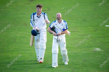 Yorkshire's Adam Lyth (r) leaves the field with George Hill after finishing the day's play against Lancashire on 86 not out.