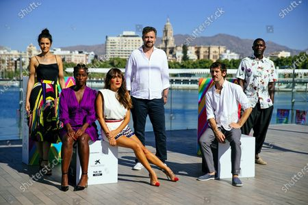 Stock Image of Esteban Crespo (C) and cast members (from-L) Melina Mathews, Lidia Nene, Candela Pena, Raul Arevalo and Emilio Buale pose for the photographers during the presentation of the film 'Black Beach' in the framework of 23rd Spanish Film Festival in Malaga, southern Spain, 23 August 2020. The film competes in the official section of the festival running from 21 to 30 August. The festival was postponed due to coronavirus lockdown last March.