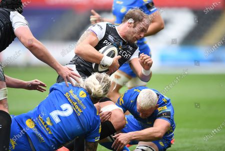 Stock Photo of Alun Wyn Jones of Ospreys is tackled by Richard Hibbard and Ben Fry of Dragons.